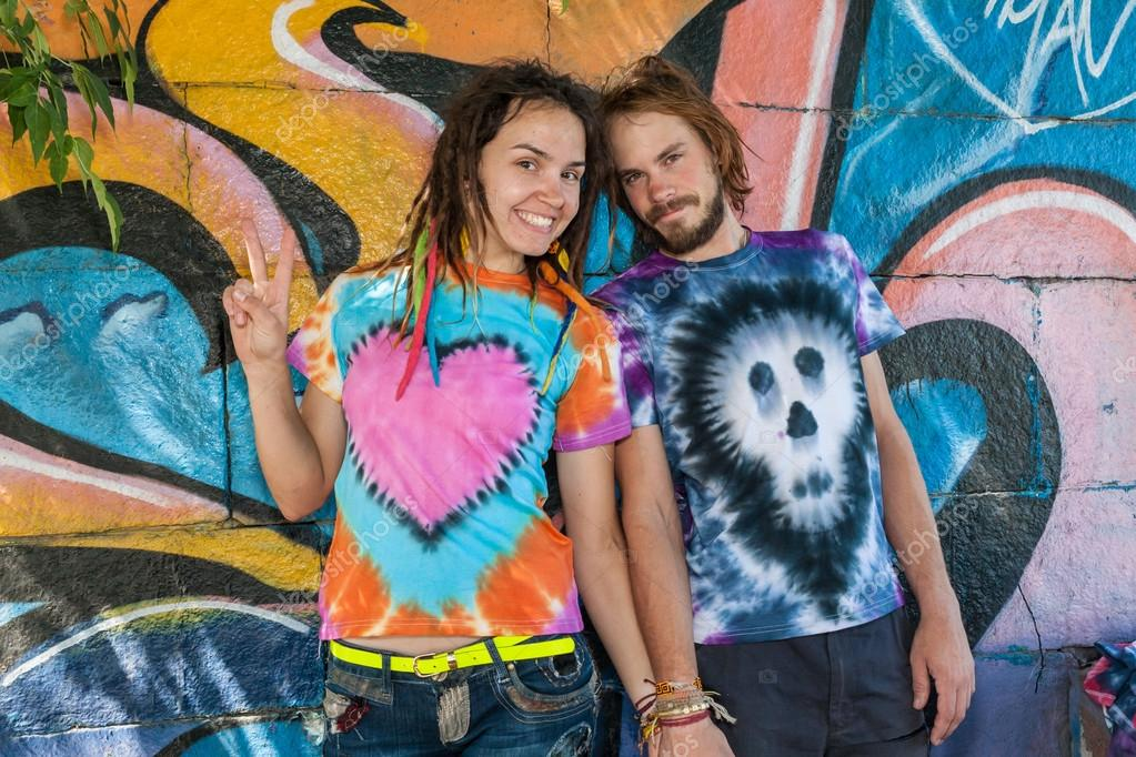 Very happy and bright people in T-shirts Hippie