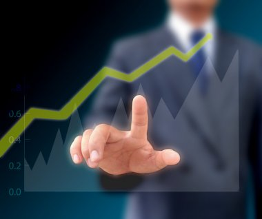 Businessman watching the upward trend of a graphic chart.