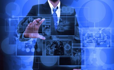 businessman holding Reaching images streaming in hands .Financia