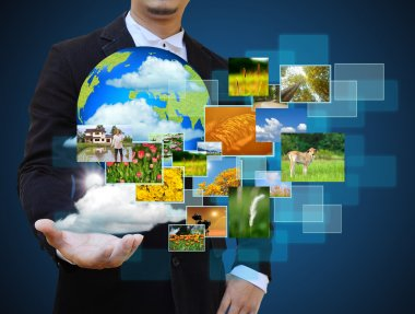 Businessman holding green Earth in hands