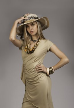 Beautiful blonde girl in safari outfit with hat