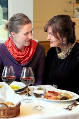 Two women chatting in restaurant