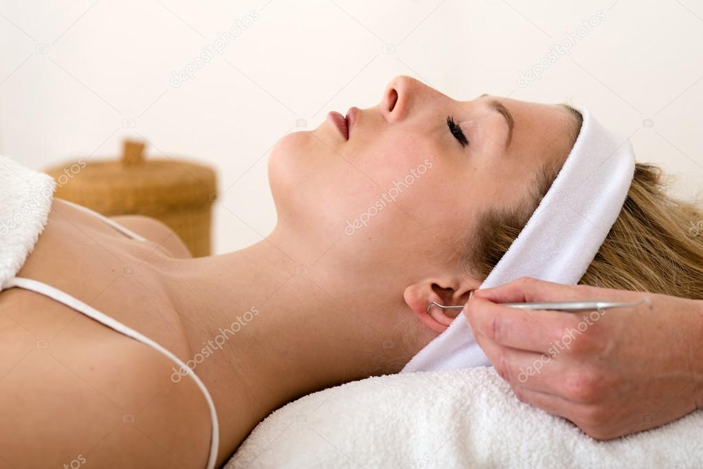 Homeopath Applying Auriculotherapy Techniques Stock Photo