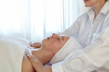 Woman In Spa With Therapsist