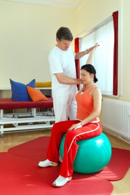 Physiotherapist Exercising With Patient