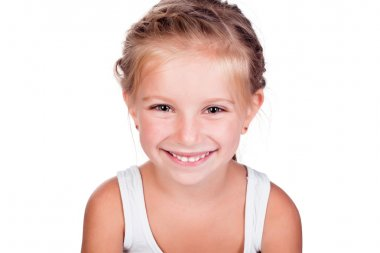 A smiling cute little girl isolated on a white background