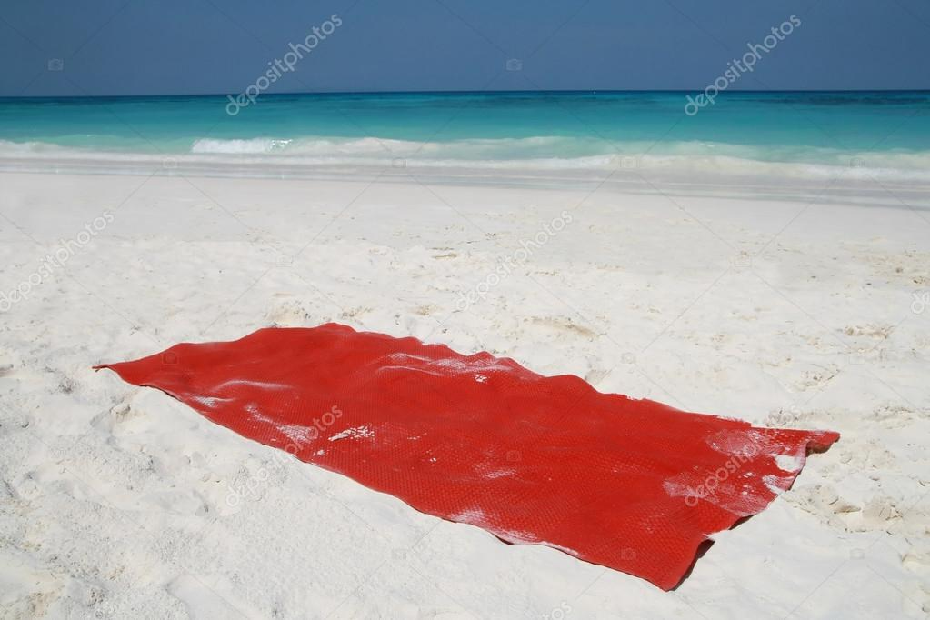 Red towel on beatiful beach, Tachai island, Similan island group