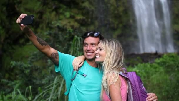 Young Happy Couple Taking Selfie Photo By Waterfall