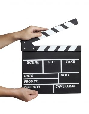 Male hands holding a clapboard