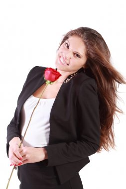 Smiling woman with flying hair holds red rose isolated on white