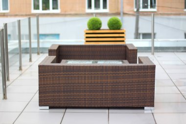 Table and wicker sofas in summer cafe on cinema terrace