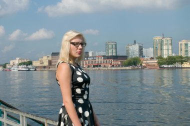 A girl with glasses on the banks of the Khimki reservoir, the Moscow