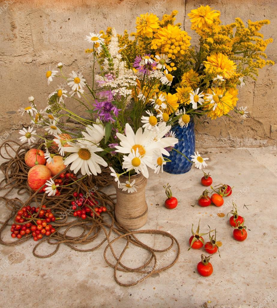 Still life with two wild flowers bouquets