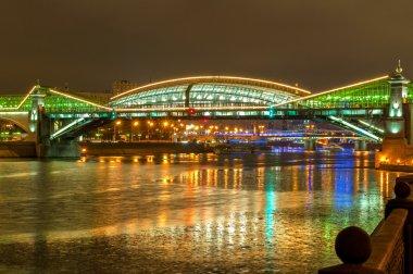Bogdan Khmelnitsky bridge at night in Moscow. The beautiful pedestrian bridge across the Moscow River.