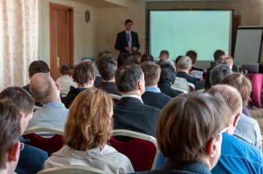 People rear on the business seminar and speaker at the screen