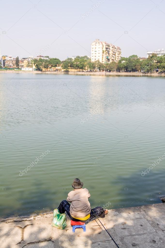 Old men fishing on lake