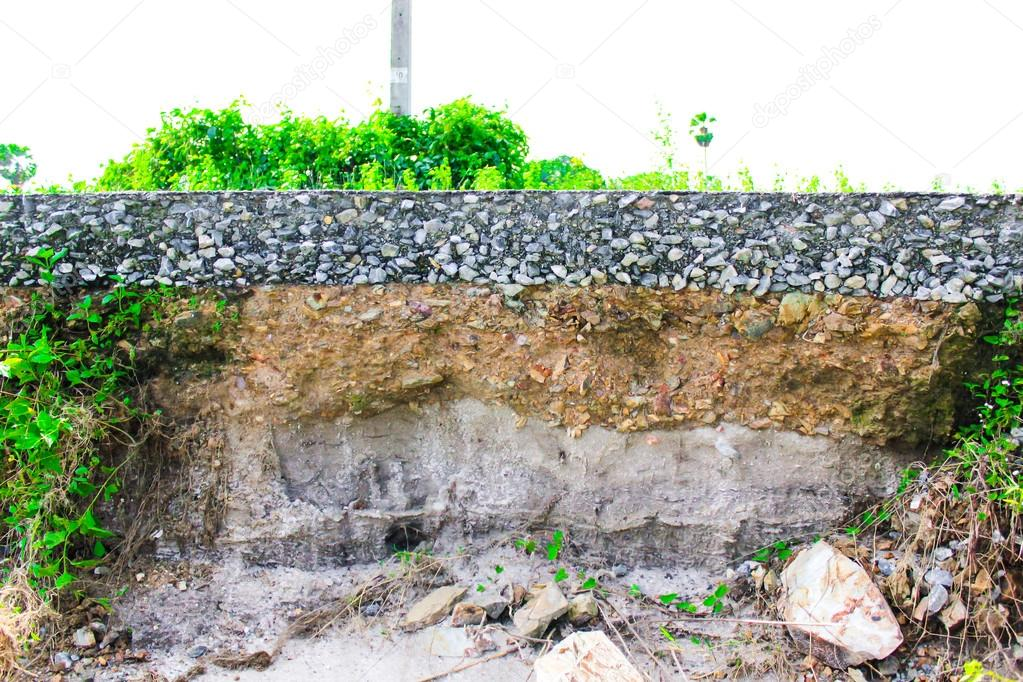 damage the asphalt road cut of soil layer with different visible