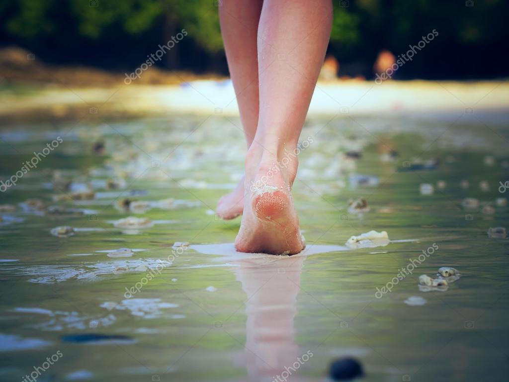 Walking girl on the beach