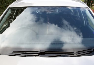 Front View Of Car Windshield And Windscreen Wiper Blades