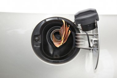 Concept Banknotes Feeding Into Petrol Refill Pipe