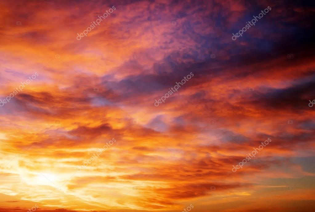 Fiery orange sunset sky. Beautiful sky. Sky Background