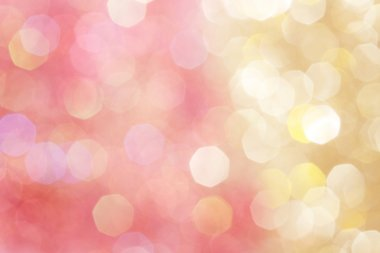 Gold and pink abstract bokeh lights, defocused background