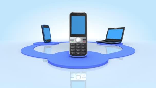 notebook, mobilní telefon a smartphone rotující reflexní patře. 1080 p HD. Maska alfa součástí. smyčky animace