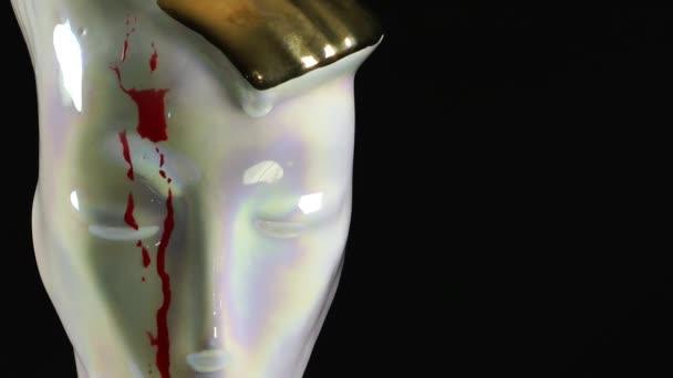 Keramický obličej a krev