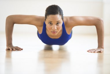 Determined Woman Doing Push Ups In Gym