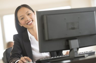 Portrait Of Businesswoman Working On Computer