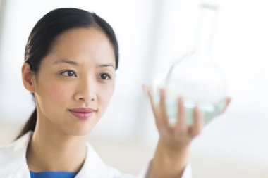 Close-Up Of Scientist Analyzing Chemical Solution
