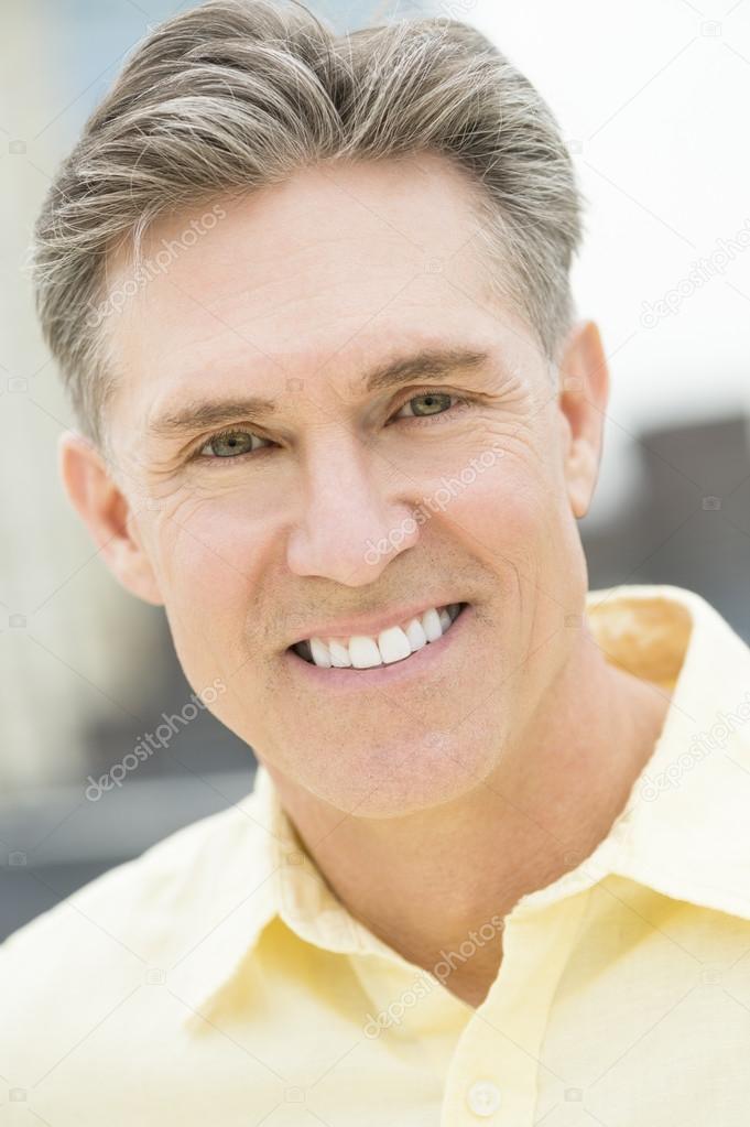 Portrait Of Mature Man Smiling Outdoors