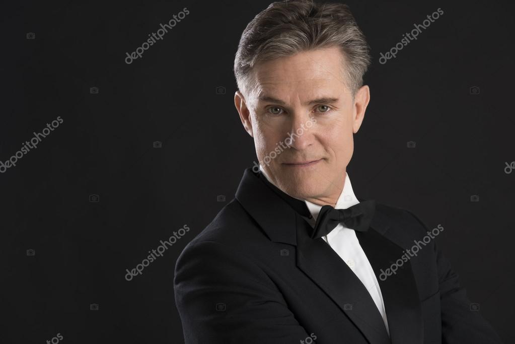Portrait Of Confident Mature Man In Tuxedo