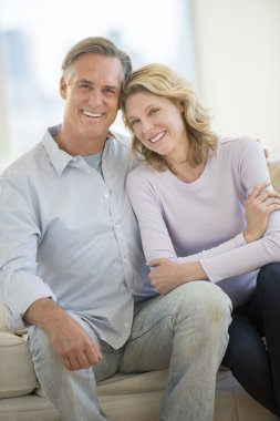 Loving Couple Smiling Together At Home