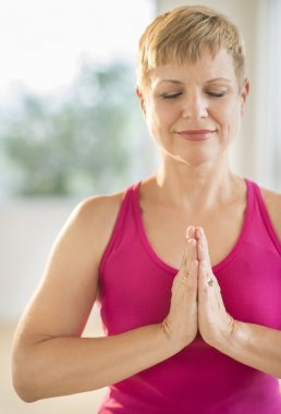 Woman In Prayer Position Practicing Yoga