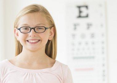 Girl Wearing Glasses Against Eye Chart