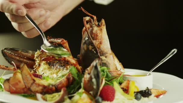 Chef Serving Lobster Dish in Luxury Restaurant, Close-Up.