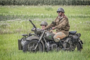 Soviet soldiers riding a sidecar