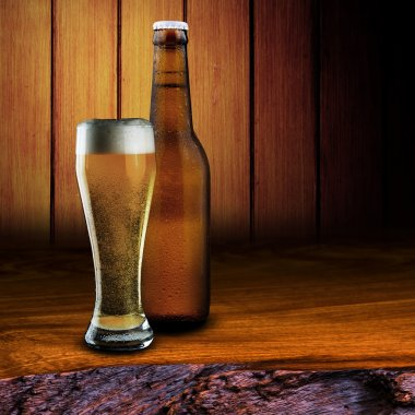 Glass and bottle of cold beer