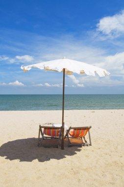 Beach chairs on sand beach