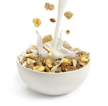 Pouring milk into a bowl with breakfast cereal