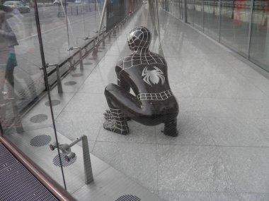 Spider man behind the glass