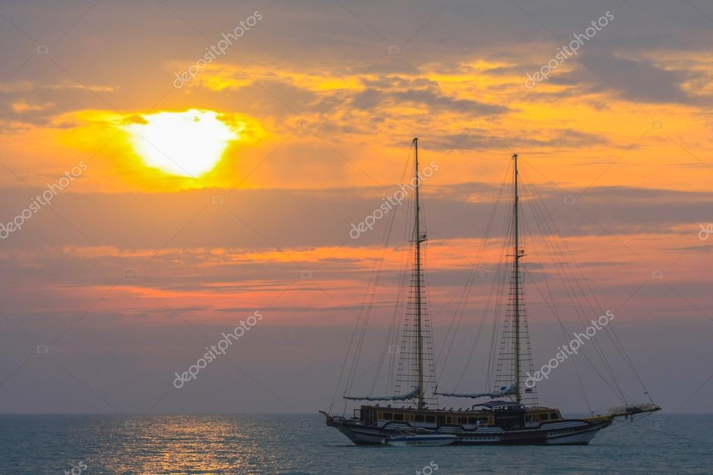 Background sunset with sea and boat
