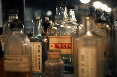 Close-up of poison in antique bottle
