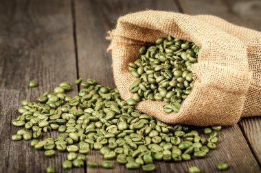 Green coffee beans in bag
