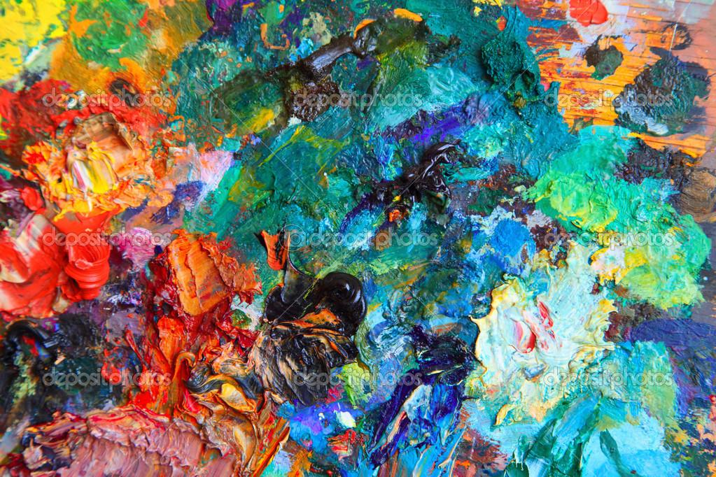 Background image of bright oil-paint palette closeup ...