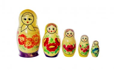 Multi-colored dolls matrioshka on a white background