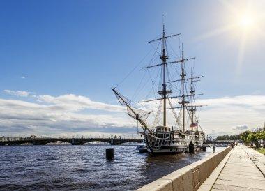 A sailboat on the river Neva and the Troitsky Bridge in Saint Pe