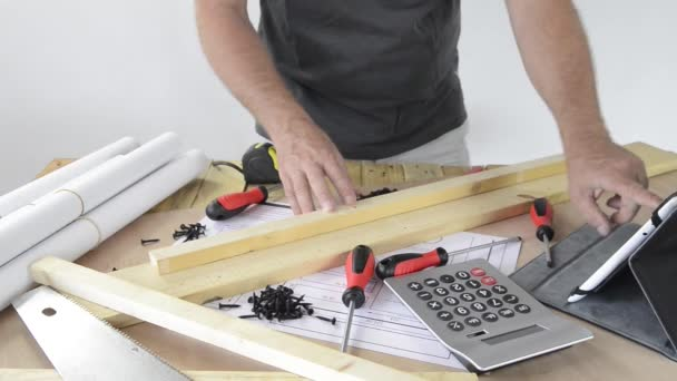 A man made a piece of furniture with various carpentry tools