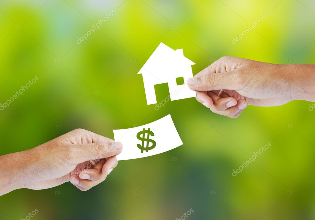 Hand with paper money and house shape